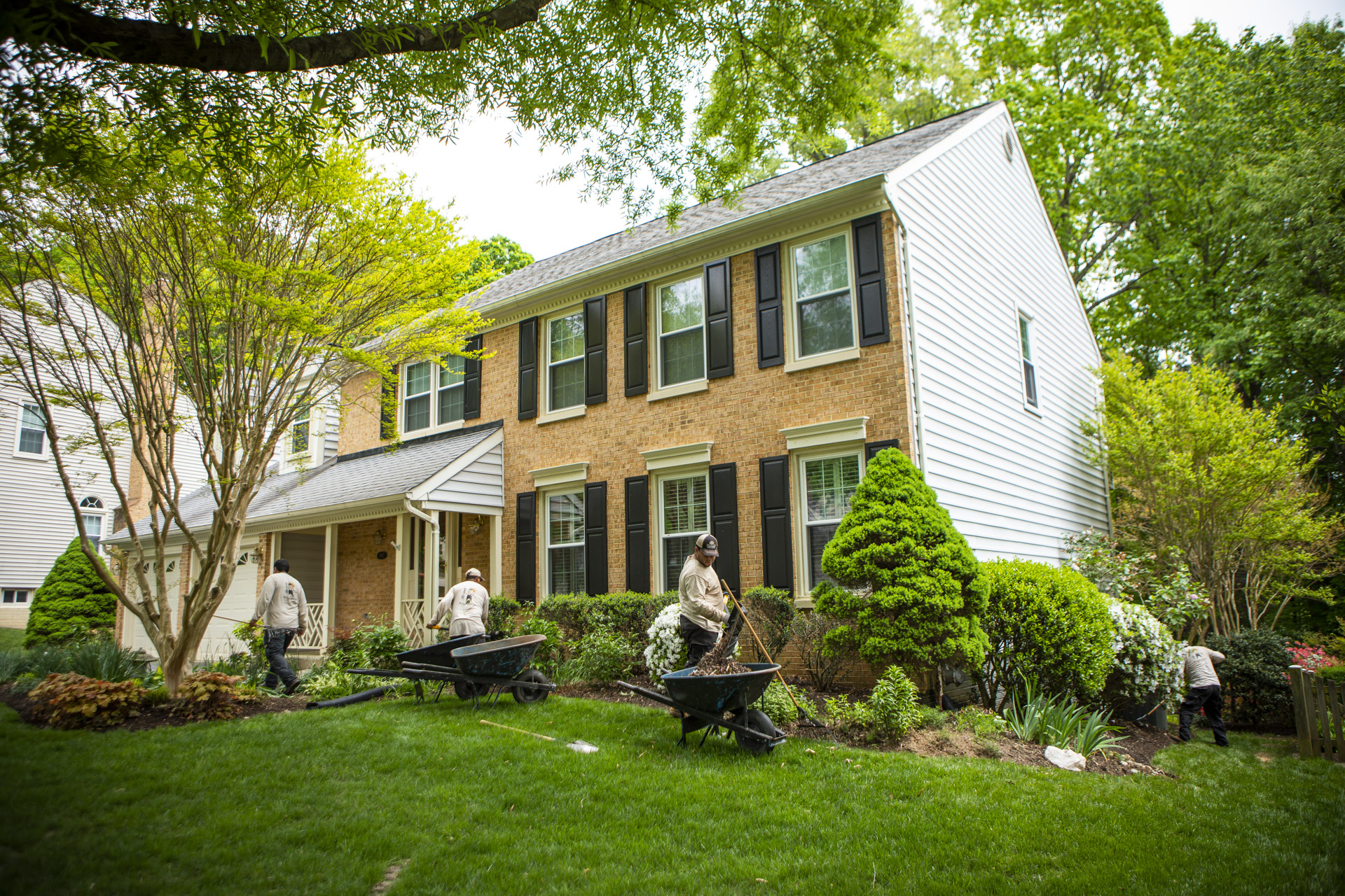landscape maintenance technicians caring for lawn and landscape