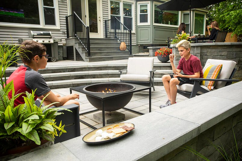 patio design with children and fire pit