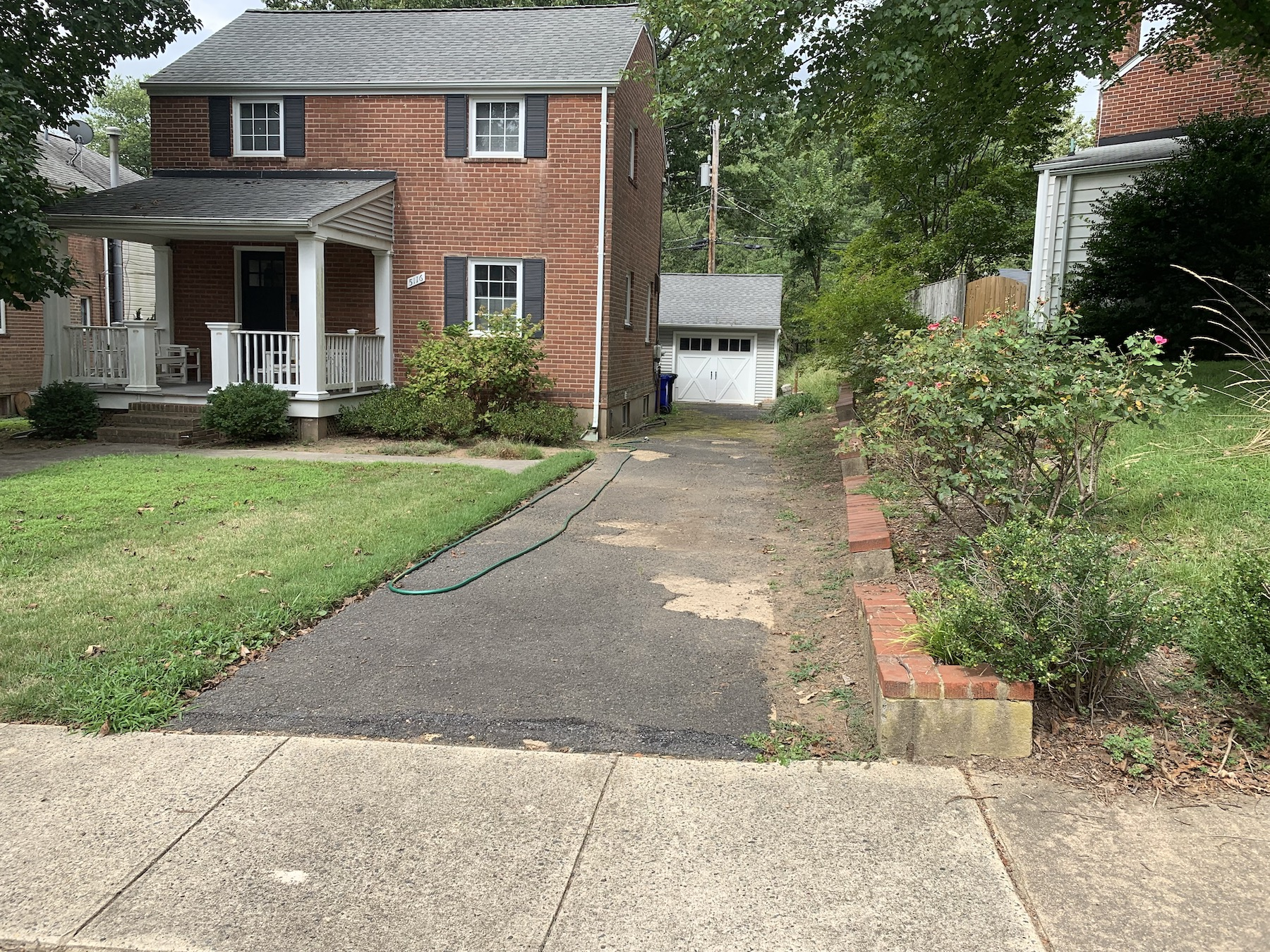arlington va landscaping project before image before driveway, retaining wall and front porch