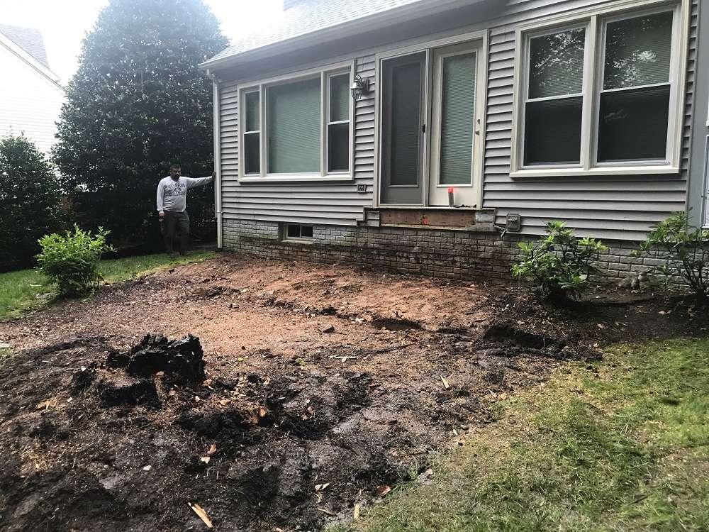 sloped yard before landscape redesign