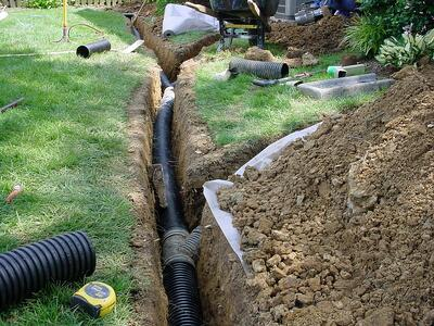 Lawn drainage solution installation