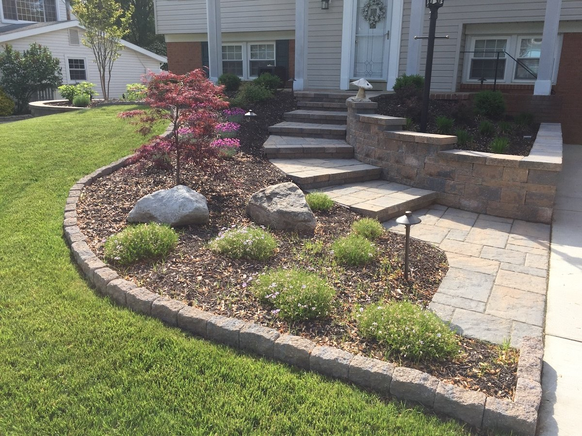 plant bed with edging in front yard landscape