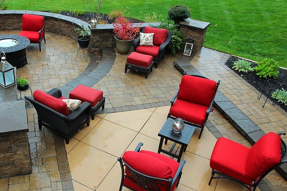 Paver patio with plants and furniture