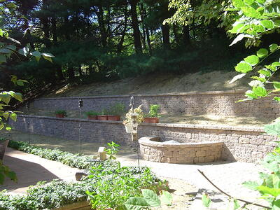 sloped yard with retaining wall and terrace in Virginia