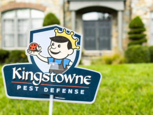 Kingstowne Pest Defense sign in lawn