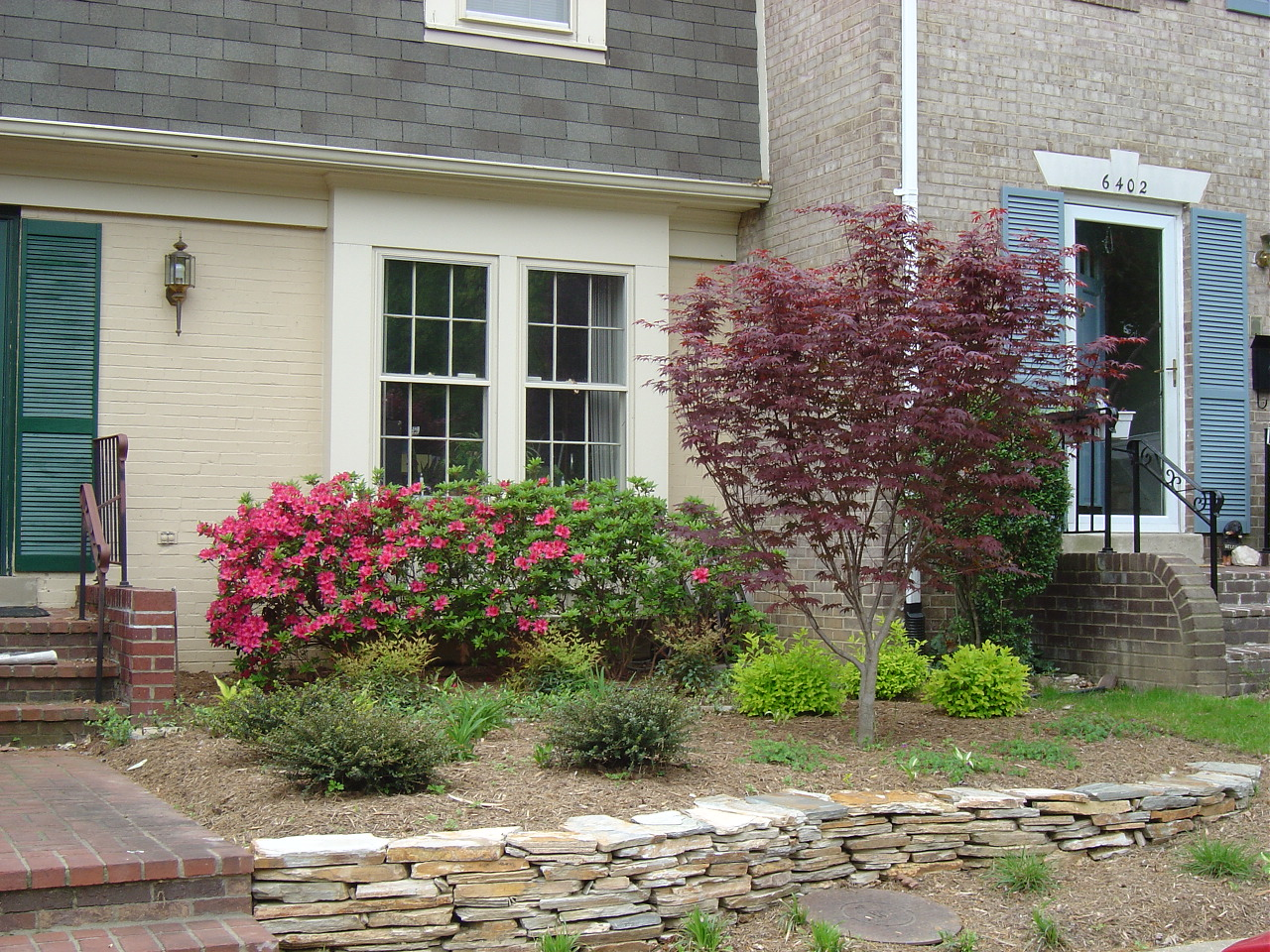 Townhouse with curb appeal from colorful plants