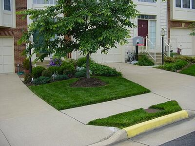 Townhouse with beautiful professional landscaping
