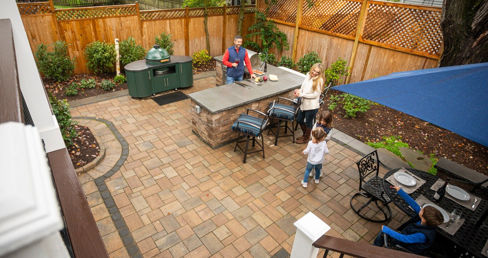 Paver patio with outdoor kitchen and bar area