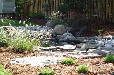 pondless waterfall water feature in backyard