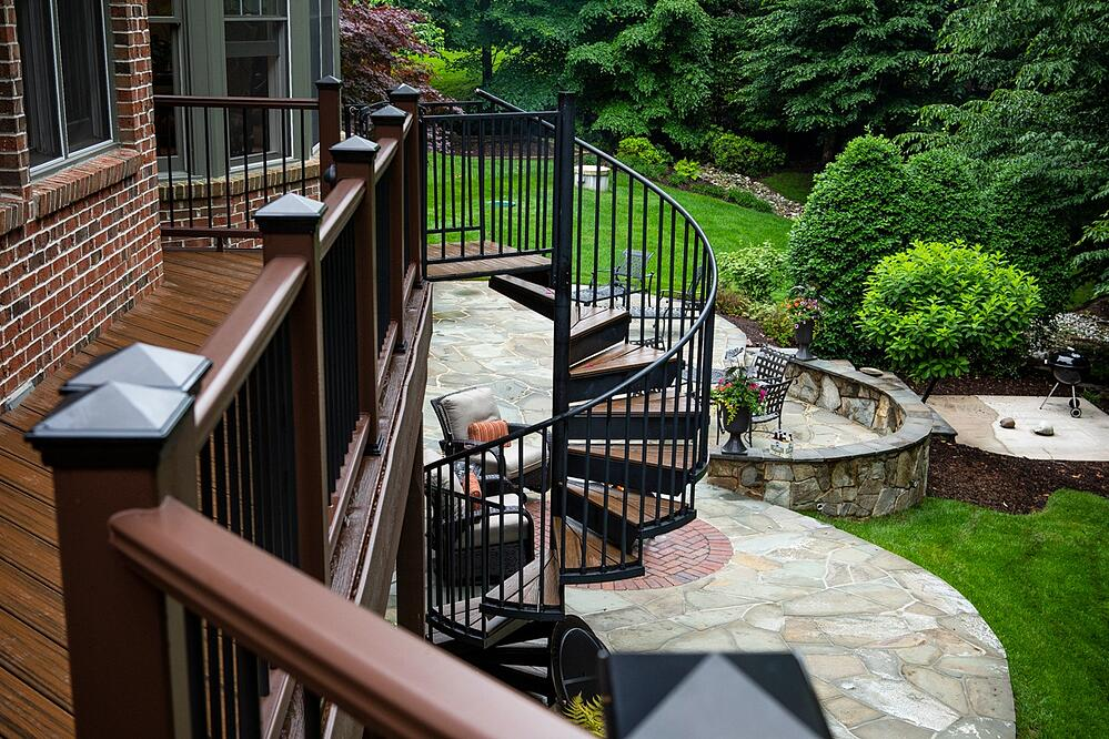 deck designed with spiral staircase to patio