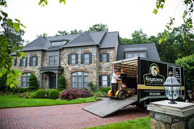 Employee with lawn mowing job for Kingstowne Lawn & Landscape