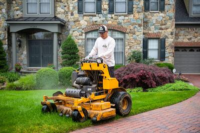 lawn mowing professional working at job in Alexandria, VA