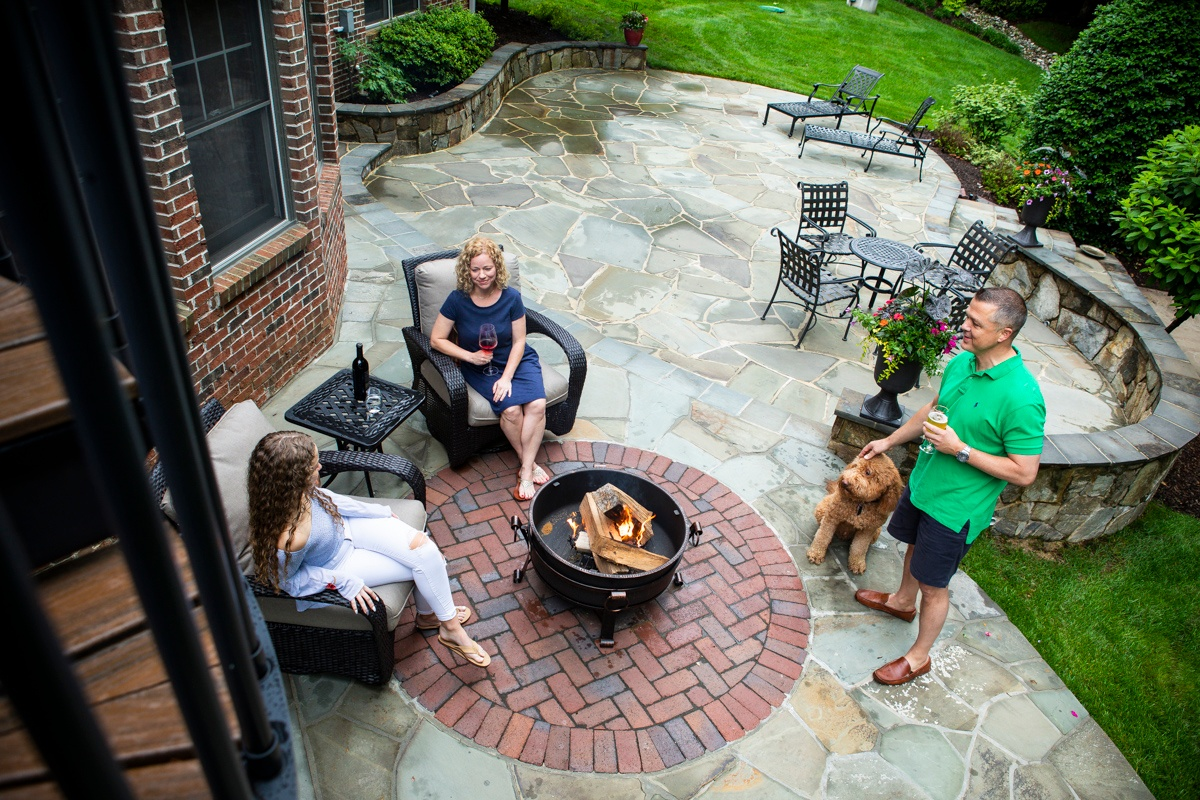customers enjoying their patio and fire pit