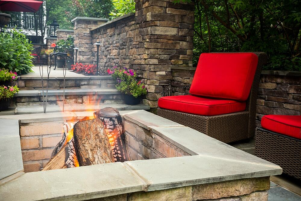 patio with fire pit and walls