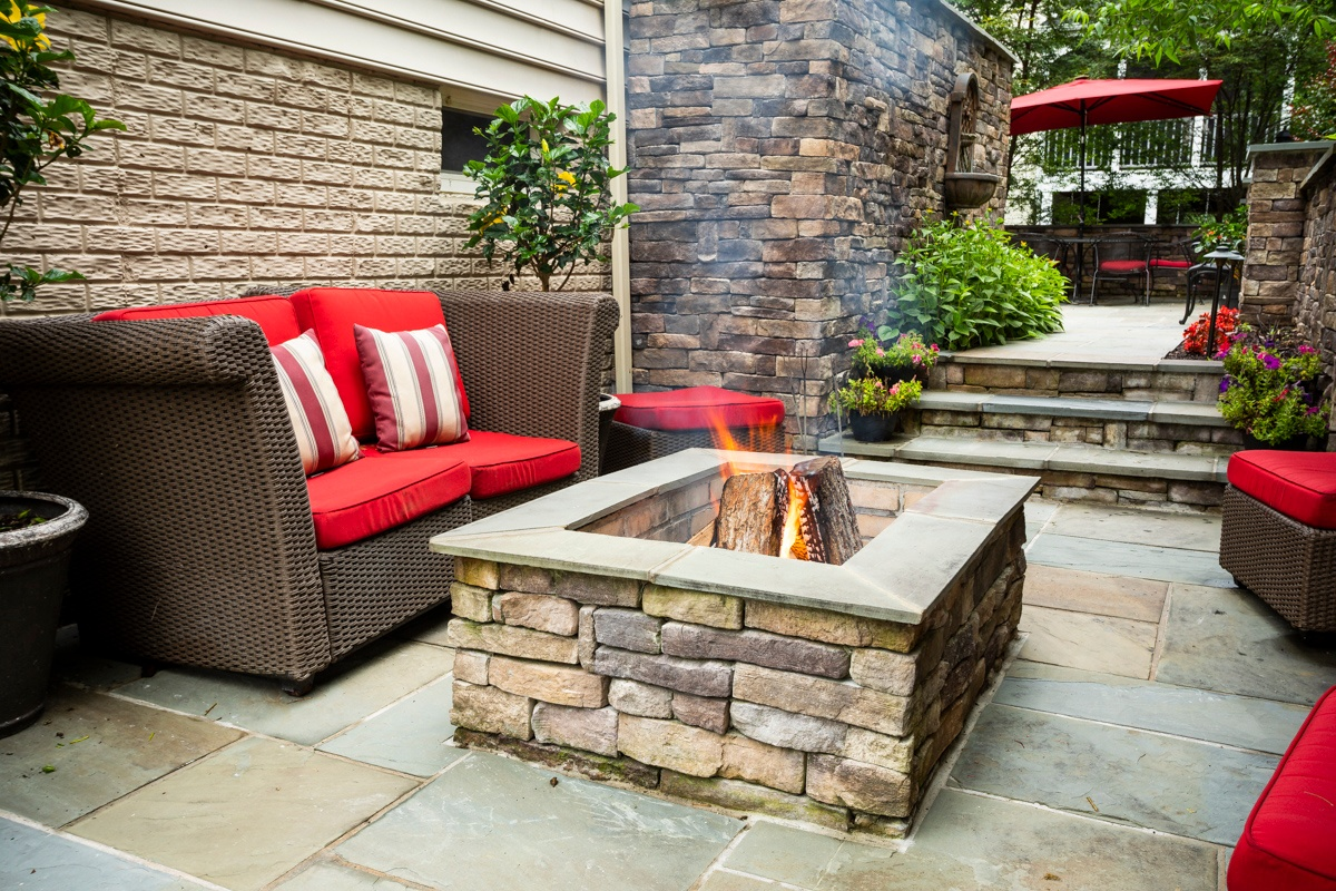 Rectangular fire pit on patio with furniture