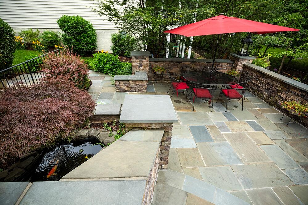 patio dining area with fish pond in Alexandria, VA