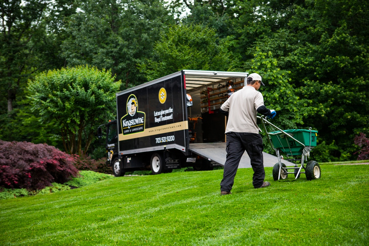 Kingstowne lawn care technician treating lawn